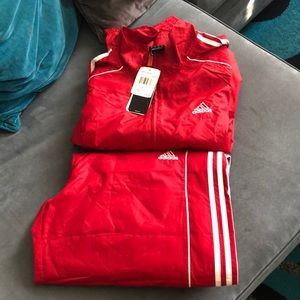 Two pics adidas track suit